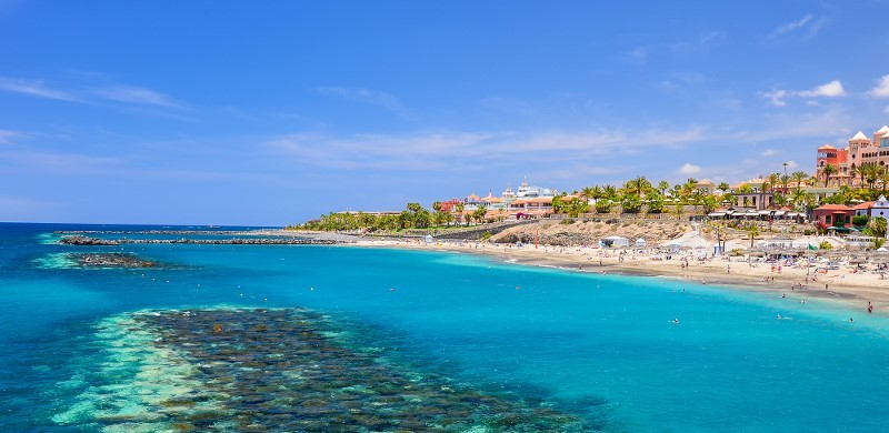 http://www.debontravel.it/wp-content/uploads/2018/02/Beautiful-turquoise-sea-water-on-El-Duque-beach-Tenerife-Canary-islands-Spain_shutterstock_215402416.jpg